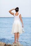 Girl on seashore Stock Photography