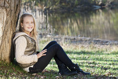 Girl seated in a park Royalty Free Stock Image