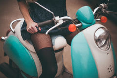 Girl seating on moto bike Royalty Free Stock Images