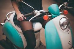 Girl seating on moto bike Royalty Free Stock Images
