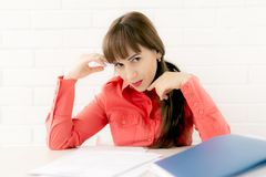 Secretary sitting on desk reading documents, seduction stock photos