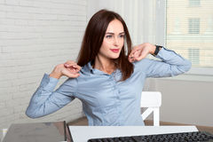 Girl secretary stretches himself tired from work Royalty Free Stock Photo
