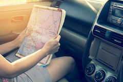 Girl see map in the car. Royalty Free Stock Photos