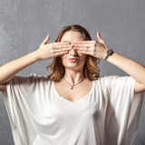 Girl in see no evil pose Royalty Free Stock Image