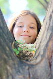 Girl see on plant Royalty Free Stock Photo