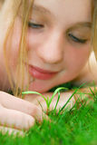 Girl and seedling Royalty Free Stock Image