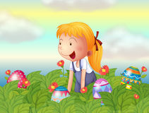 A girl seeing eggs in the garden Royalty Free Stock Photo