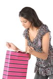 Girl seeing the shopping bag with surprise Royalty Free Stock Photo