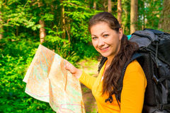 Girl seeks the path to map forest Royalty Free Stock Image