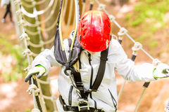 Girl seen from above climbing in high rope course Royalty Free Stock Image