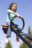 Girl on Seesaw Stock Photo