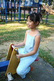 Girl on seesaw Stock Photos