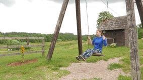 Girl on a seesaw stock footage