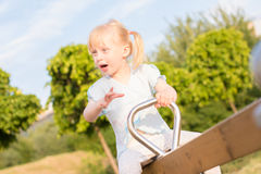 A girl on seesaw Stock Image