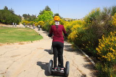 Girl on Segway - The leader in personal, green tra stock images