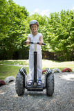 Girl Segway Ride Stock Images