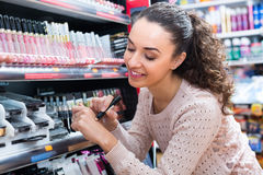 Girl selecting beauty treatment in shop Royalty Free Stock Photography