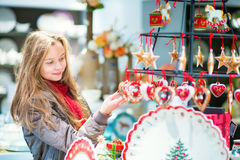 Girl selecting Christmas decorations Royalty Free Stock Images