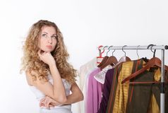 Girl selecting clothes in shop Stock Photo