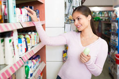 Girl selecting deodorant in cosmetics store Stock Photography