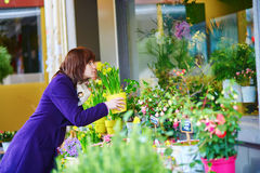Girl selecting flowers in a Parisian flower shop Royalty Free Stock Image