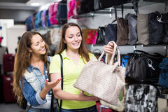 Girl selecting handbag in commercial centre Royalty Free Stock Photos
