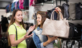 Girl selecting handbag in commercial centre Stock Images