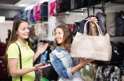 Girl selecting handbag in commercial centre Stock Photo