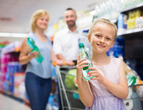 Girl selecting non-alcoholic beverage Royalty Free Stock Photo