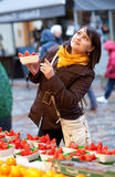 Girl selecting strawberries at market Stock Photo