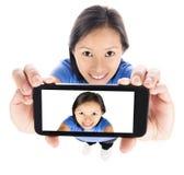 Girl Selfie. Asian girl selfie isolated on white royalty free stock photo