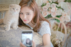 Girl Selfie cat with a cute little girl . Royalty Free Stock Photography