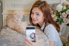 Girl Selfie cat with a cute little girl . Royalty Free Stock Photos