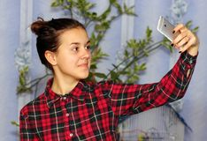 Girl selfie. Girl taking photo with her smart phone. Selfie royalty free stock image