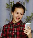 Girl selfie. Girl taking photo with her smart phone. Selfie royalty free stock photography