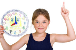 Girl with a selfmade clock Stock Photography