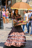 Girl seller with candy dressed in retro clothing Royalty Free Stock Image