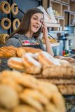 Girl selling bakery products in Greece. Young pretty girl selling bakery products in bakery in Zakynthos town, Greece royalty free stock images