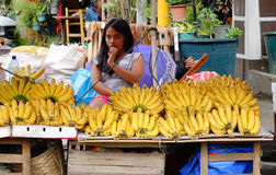 A girl selling banana at the market in Manila, Philippines Royalty Free Stock Photo