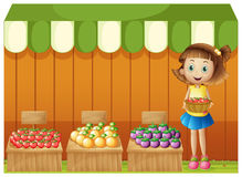 A girl selling different fruits Stock Images