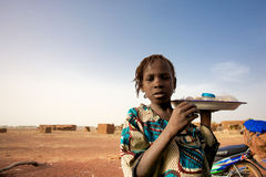 Girl selling food and water on the road to Mopti Royalty Free Stock Images