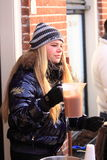 Girl selling hot chocolate drinks Stock Images