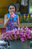 A girl selling lotus flowers at Kataragama temple complex in southern Sri Lanka. Stock Images