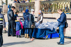 The girl selling sailor shirts at the Lieutenant Schmidt embankment. Royalty Free Stock Image