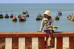 Girl selling seashells in Fishing village in Muine, Vietnam Stock Photography