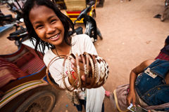 Girl sells bamboo bracelets Angkor Wat Stock Photo