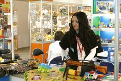 The girl sells toys. MOSCOW - MARCH 16: The girl sells toys presented at the International Specialized Exhibition the Toy Russia March 16, 2011 in Moscow Stock Images