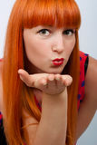 Girl sending air kiss Royalty Free Stock Image