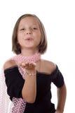 Girl sending blowing kiss Stock Image