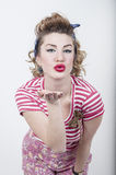 Girl sending a kiss Royalty Free Stock Images